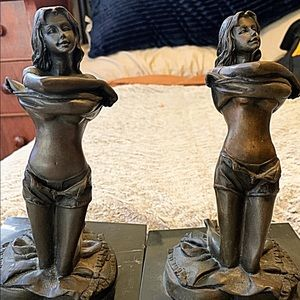 Brass bookends with marble base. Scantily dressed.